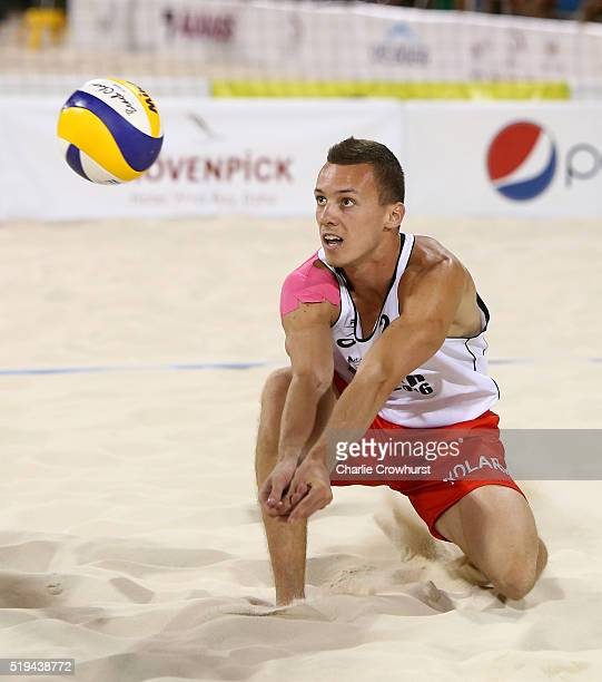 Lazar Kolaric of Serbia gets down low to return the shot during the main draw match between Belgium and Serbia on day three of the FIVB Qatar Open at...