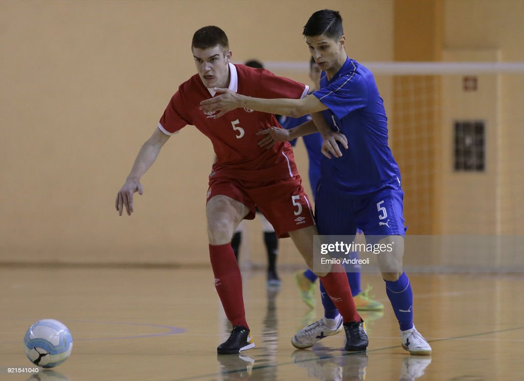 Lazar Marinkovic (L) of Serbia is challenged by Dario Filipponi of Italy during the Futsal International Friendly match between Italy U19 and Serbia U19 at Novarello Training Center on February 20, 2018 in Novara, Italy.