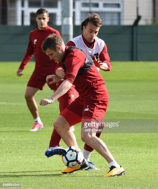Lazar Markovic and James Milner of Liverpool during the UEFA Champions League group E match between Liverpool FC and Sevilla FC at Anfield on...