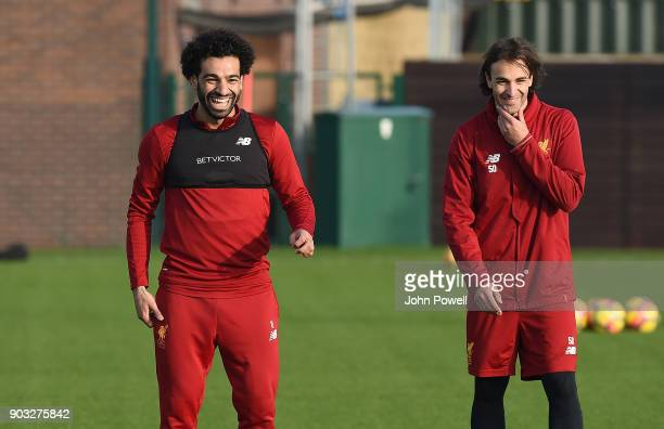 Lazar Markovic and Mohamed Salah of Liverpool during a training session at Melwood Training Ground on January 10 2018 in Liverpool England