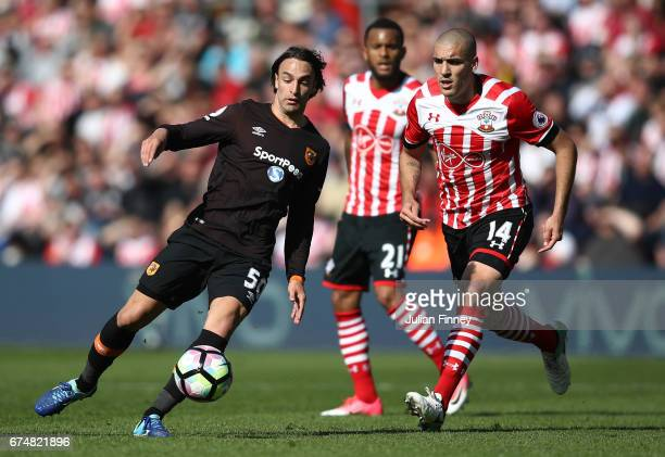 Lazar Markovic of Hull City and Oriol Romeu of Southampton in action during the Premier League match between Southampton and Hull City at St Mary's...