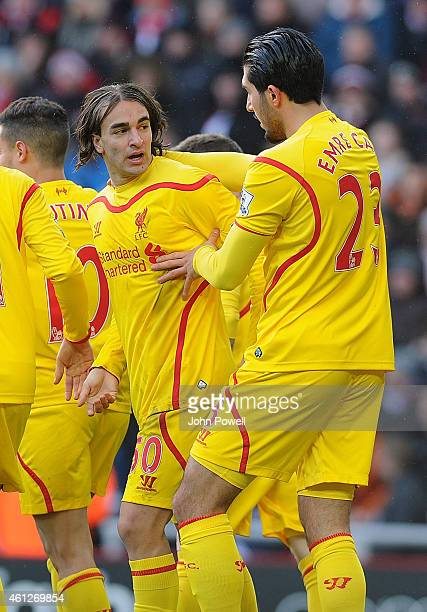 Lazar Markovic of Liverpool celebrates with Emre Can after scoring the opening goal during the Barclays Premier Leauge match between Sunderland and...