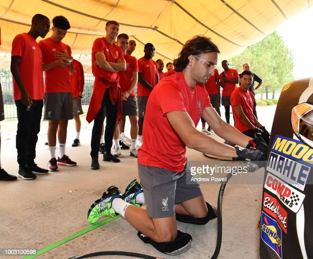 Lazar Markovic of Liverpool changing tyres during a tour of Roush Fenway Racing on July 21 2018 in Charlotte North Carolina