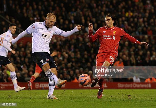 Lazar Markovic of Liverpool competes with Eidur Gudjohnson of Bolton during the FA Cup Fourth Round match between Liverpool and Bolton Wanderers at...