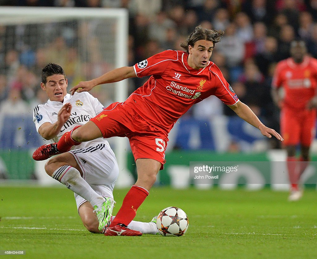 Lazar Markovic of Liverpool competes with James Rodriquez of Real Madrid CF during the UEFA Champions League Group B match between Real Madrid CF and Liverpool FC on November 4, 2014 in Madrid, Spain.