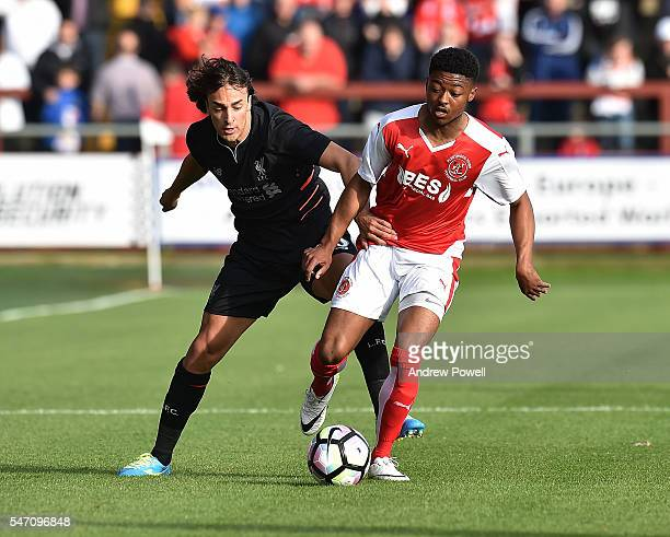 Lazar Markovic of Liverpool competes with Keano Deacon of Fleetwood Town during the PreSeason Friendly match bewteen Fleetwood Town and Liverpool at...