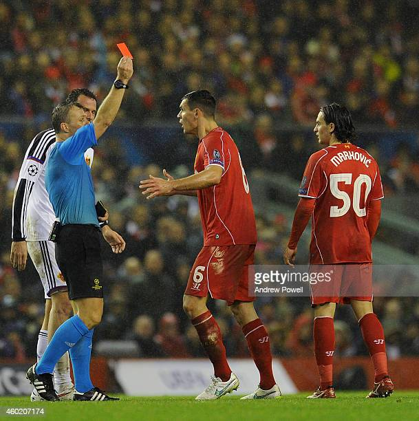 Lazar Markovic of Liverpool is shown the red card by Referee Bjorn Kuipers during the UEFA Champions League match between Liverpool FC and FC Basel...