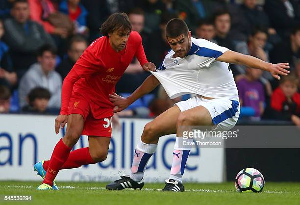 Lazar Markovic of Liverpool pulls the shirt of Evan Gumbs of Tranmere Rovers during the PreSeason Friendly match between Tranmere Rovers and...