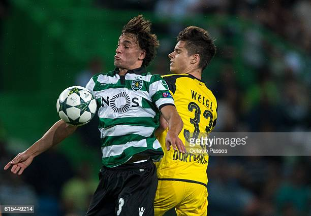 Lazar Markovic of SC Sporting competes for the ball with Julian Weigl of Borussia Dortmund during the UEFA Champions League match between SC Sporting...