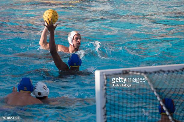 Lazar Pasuljevic of USC looks to pass the ball during the Division I Men's Water Polo Championship held at the Uytengsu Aquatics Center on the...
