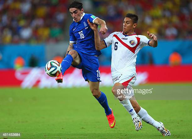 Lazaros Christodoulopoulos of Greece controls the ball against Oscar Duarte of Costa Rica during the 2014 FIFA World Cup Brazil Round of 16 match...