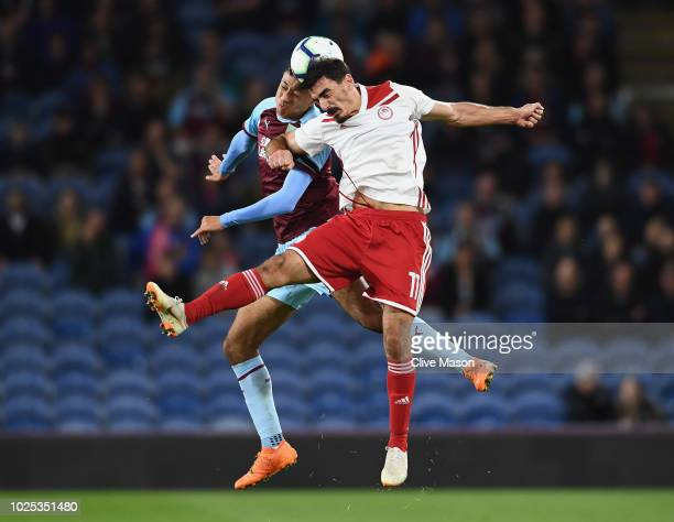 Lazaros Christodoulopoulos of Olympiakos is challenged by Dwight McNeil of Burnley during the UEFA Europa League qualifing second leg play off match...