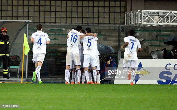 Lazaros Christodoulopoulos of UC Sampdoria is surrounded by team mates after scoring his team's third goal during the Serie A match between Hellas...