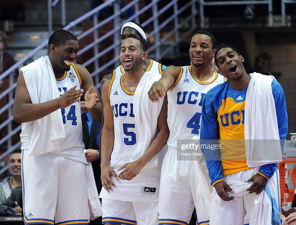 Lazeric Jones #11, Norman Powell #4, Jerime Anderson #5 and Joshua Smith #34 of the UCLA Bruins react from the sidelines during a 82-39 win over the UC Davis Aggies at Honda Center on December 17, 2011 in Anaheim, California.