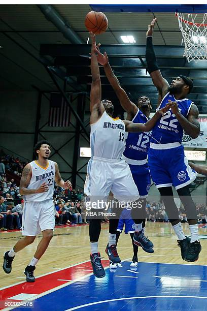 Lazeric Jones of the Iowa Energy shoots against the defense of Xavier Ford and Branden Dawson of the Grand Rapids Drive during the second half of an...