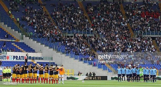 Lazio and US Lecce players stand for a minute of silence in memory of the late Italian football player Piermario Morosini of Livorno who died during...