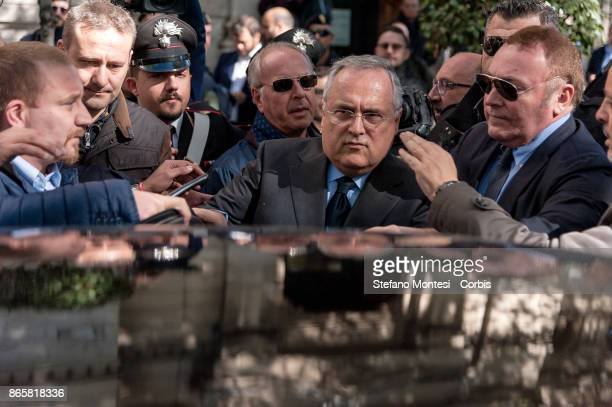 Lazio Chairman Claudio Lotito and a delegation including players Wallace and Felipe Anderson lay flowers at Rome's synagogue after a group of the...