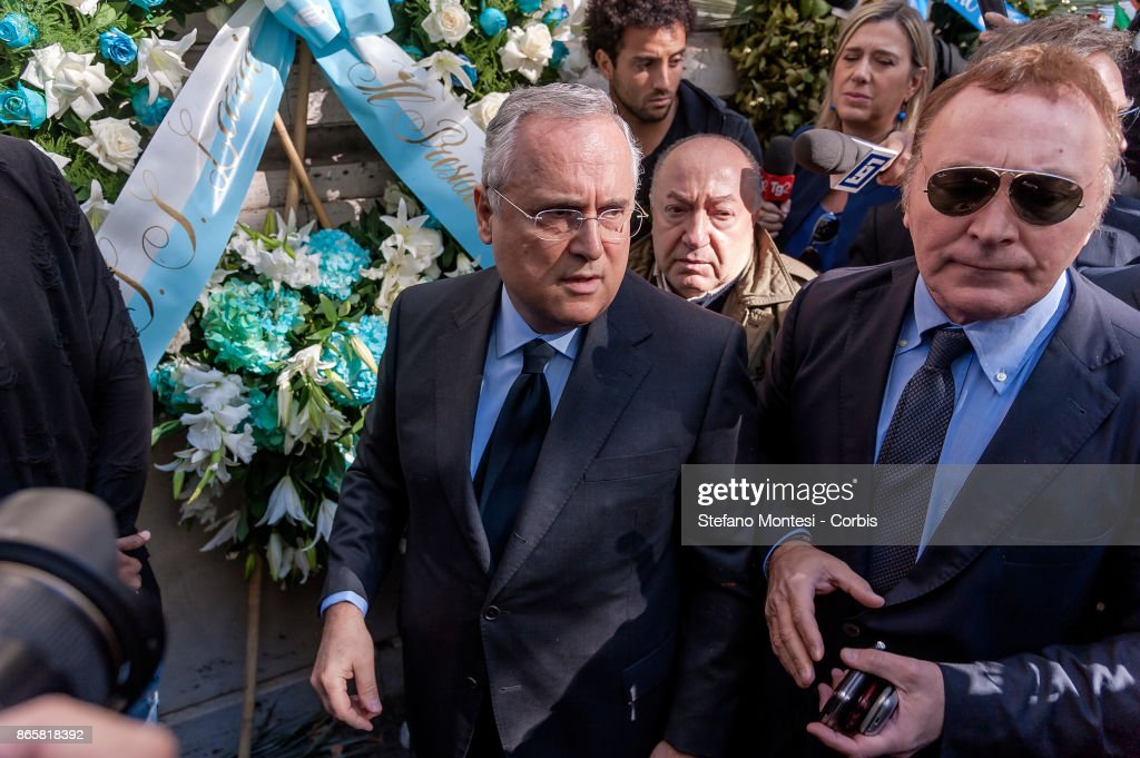 Lazio Chairman Claudio Lotito (C) and a delegation including players Wallace and Felipe Anderson lay flowers at Rome's synagogue after a group of the club's ultras of Lazio used Anti-Semitic stickers with the image of Anne Frank wearing a Roma shirt to insult followers of city rivals AS Roma on October 24, 2017 in Rome, Italy. The stickers and anti-Semitic slurs were found on glass barriers, walls and bathrooms in a section of Rome's Olympic Stadium that was used by Lazio supporters on Sunday in their Serie A match against Cagliari.