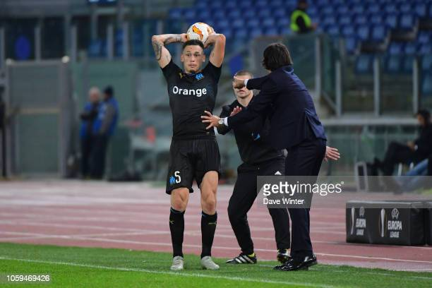 Lazio coach Simone Inzaghi tries to stop Lucas Ocampos of Marseille from taking a quich throwin during the UEFA Europa League match between Lazio...
