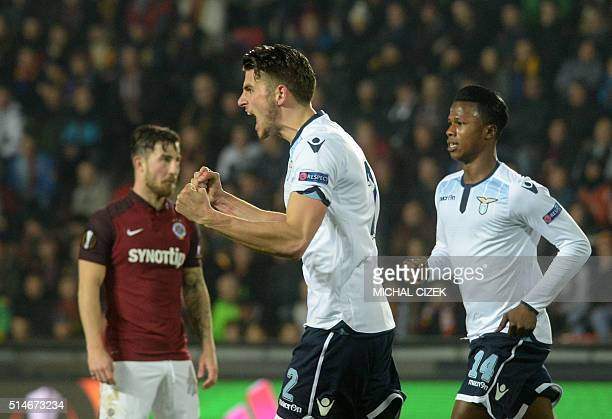 Lazio Dutch defender Wesley Hoedt celebrates the 11 goal wth his teammate Balde Diao Keita during the UEFA Europa League Round of 16 firstleg...