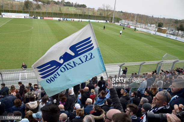 Lazio fans celebrate the victory in the derby during the SS Lazio training session at Formello Training Center on March 7 2019 in Rome Italy