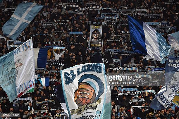 Lazio fans cheer prior the Italian Serie A football match between Lazio Rome and Juventus on November 22 2014 at the Olympic stadium in Rome AFP...