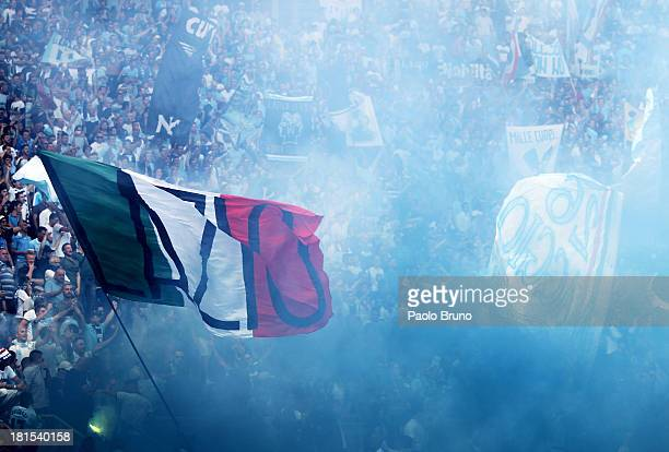 Lazio fans support their team during the Serie A match between AS Roma and SS Lazio at Stadio Olimpico on September 22, 2013 in Rome, Italy.