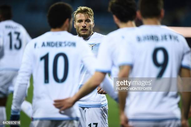 Lazio forward from Italy Ciro Immobile looks at his teammates as they celebrate during the italian Serie A football match Empoli vs Lazio at the...
