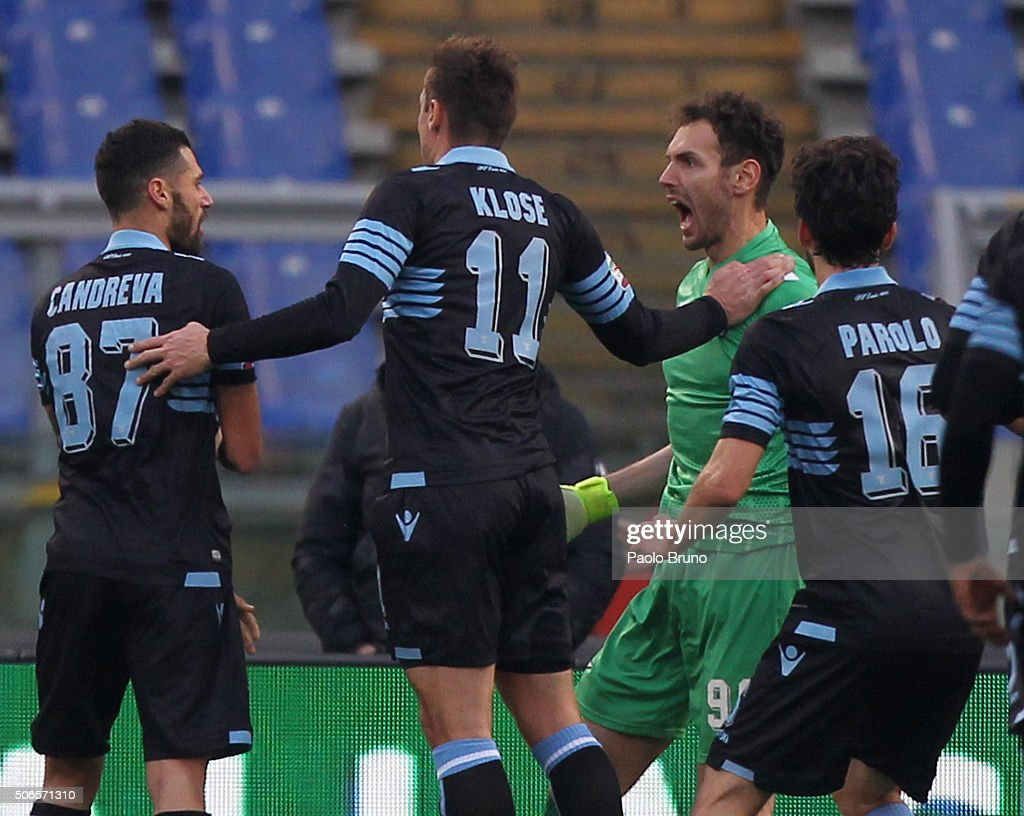 SS Lazio goalkeeper Etrit Berisha with his teammates celebrates after saving the penalty during the Serie A match between SS Lazio and AC Chievo Verona at Stadio Olimpico on January 24, 2016 in Rome, Italy.