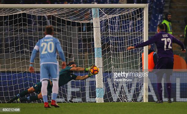 Lazio goalkeeper Federico Marchetti saves the penalty during the Serie A match between SS Lazio and ACF Fiorentina at Stadio Olimpico on December 18...