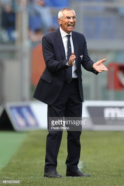 Lazio head coach Edoardo Reja gestures during the Serie A match between SS Lazio and Parma FC at Stadio Olimpico on March 30 2014 in Rome Italy