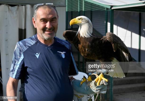 Lazio head coach Maurizio Sarri with the eagle Olimpia during the SS Lazio training session on July 21, 2021 in Auronzo di Cadore, Italy.
