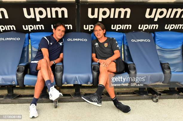 Lazio head coach Simone Inzaghi and Benevento head coach Filippo Inzaghi talk before the Friendly Match between SS Lazio and Benevento at Olimpico...