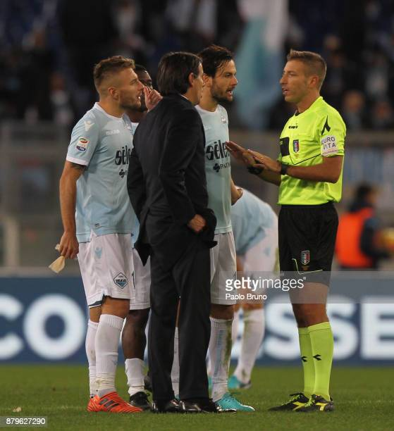 Lazio head coach Simone Inzaghi and his players react with the referee Davide Massa during the Serie A match between SS Lazio and ACF Fiorentina at...