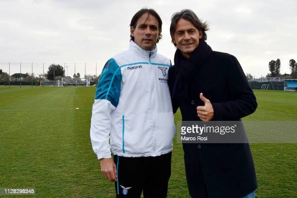 Lazio head coach Simone Inzaghi poses with his brother Filippo Inzaghi before the SS Lazio training session at Formello Training Center on March 1,...