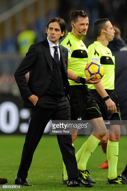 Lazio head coach Simone Inzaghi protests with the referee Piero Giacomelli at the end of the first half during the Serie A match between SS Lazio and...