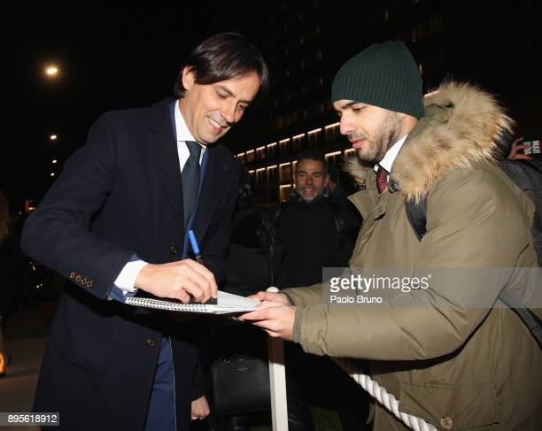 Lazio head coach Simone Inzaghi signs an autograph during the SS Lazio Christmas Party on December 19 2017 in Rome Italy