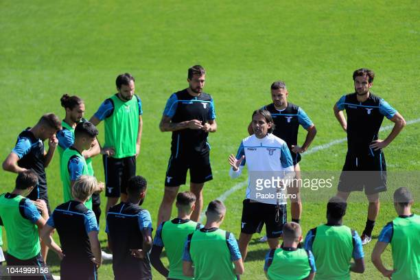 Lazio head coach Simone Inzaghi speaks with his players during the SS Lazio training session on October 3 2018 in Rome Italy