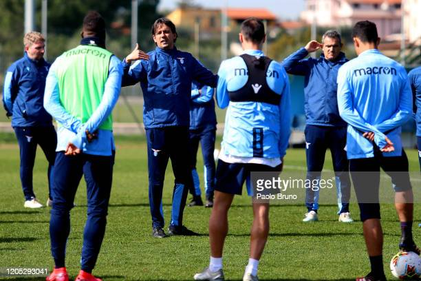 Lazio head coach Simone Inzaghi speaks with his players during the SS Lazio training session at Formello sport centre on March 5, 2020 in Rome, Italy.