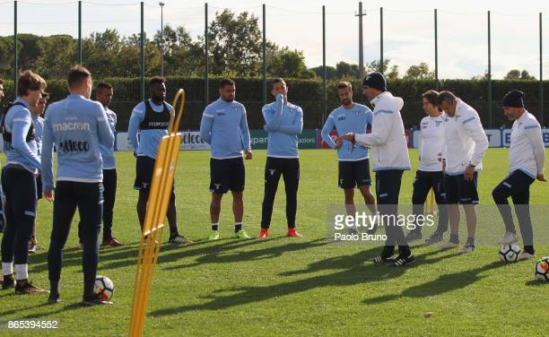 Lazio head coach Simone Inzaghi speaks with his players during the SS Lazio training session on October 23 2017 in Rome Italy