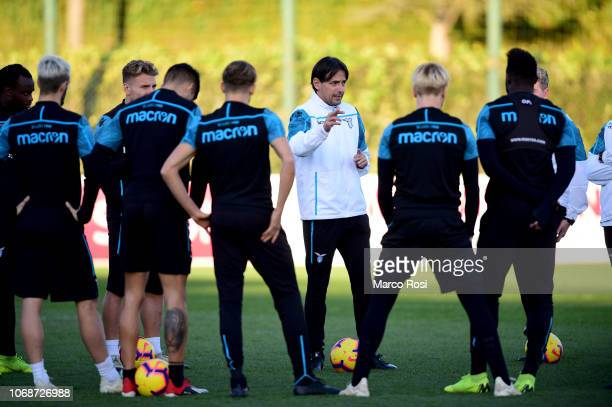 Lazio head coach Simone Inzaghi talks to his players during the SS Lazio training session at the Formello Center on December 5 2018 in Rome Italy