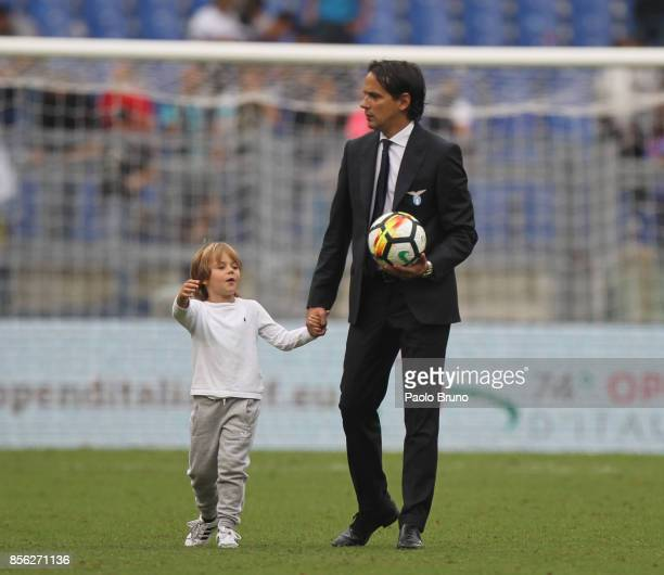 Lazio head coach Simone Inzaghi with his son look on after the Serie A match between SS Lazio and US Sassuolo at Stadio Olimpico on October 1 2017 in...