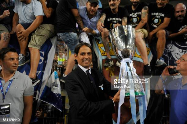 Lazio head coah Simone Inzaghi with the cup after the Italian Supercup match between Juventus and SS Lazio at Stadio Olimpico on August 13 2017 in...