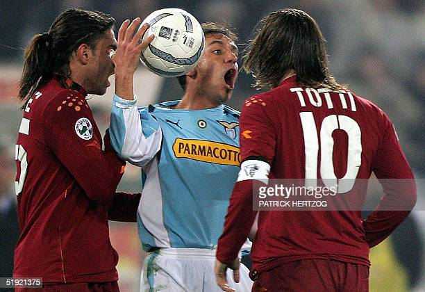 Lazio midfielder Antonio Filippini clashes with AS Roma's captain Francesco Totti during their Italian serie A football match at the Olympic stadium...