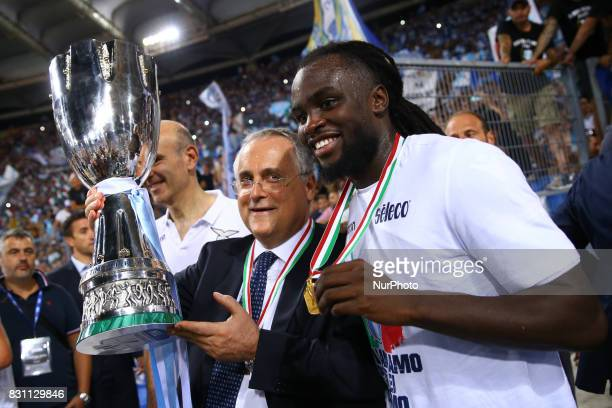 Lazio owner Claudio Lotito and Jordan Lukaku of Lazio with the cup after winning the Italian SuperCup TIM football match Juventus vs Lazio on August...