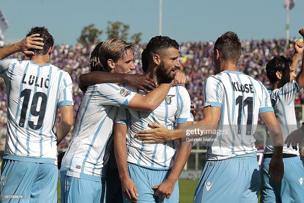 Lazio players celebrate a goal scored by Senad Lulic during the Serie A match between ACF Fiorentina and SS Lazio at Stadio Artemio Franchi on October 19, 2014 in Florence, Italy.