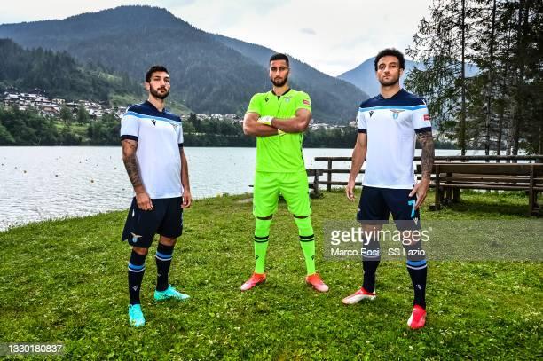 Lazio players Danilo Cataldi, Thomas Strakosha and Felipe Anderson posing in the new away kit on July 23, 2021 in Auronzo di Cadore, Italy.