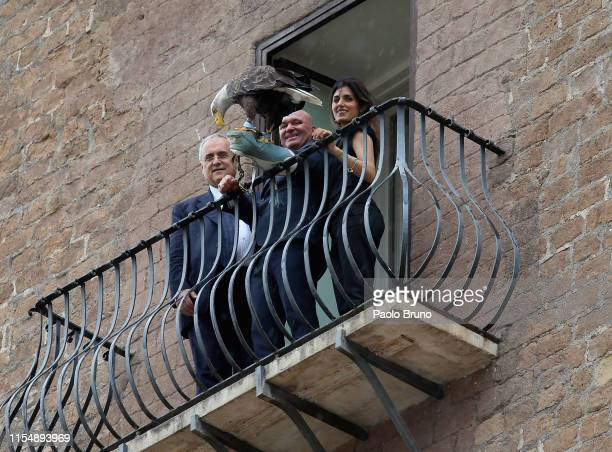 SS Lazio President Claudio Lotito and Rome Mayor Virginia Raggi with the eagle mascot Olimpia look on during the award ceremony for the victory of...