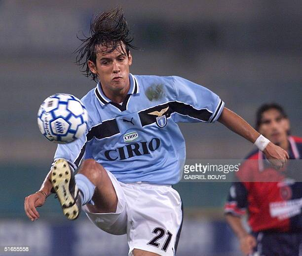 Lazio Roma's striker Simone Inzaghi controls the ball ahead of Cagliari's defender Fabio Macellari during their Italian Serie A game 30 August 1999...