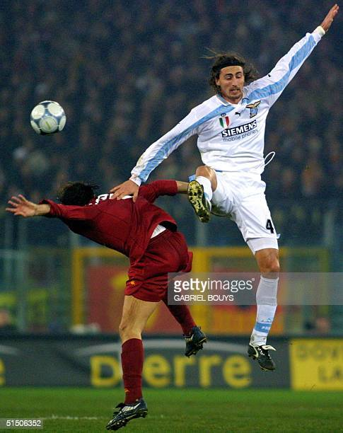 Lazio Rome midfielder Dino Baggio vies with AS Roma midfielder Cristiano Zanetti during the derby match Lazio RomeAS Rome 17 December 2000 in Rome's...